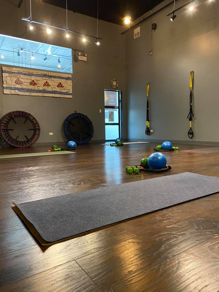 fitness studio with mats, trampolines, exercise balls