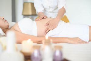 pregnant woman receiving a massage
