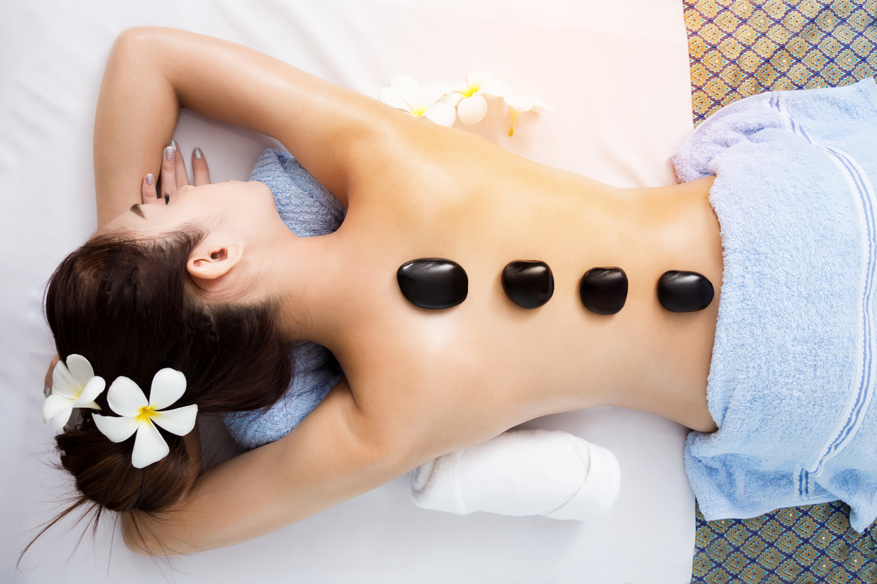 woman with hot stones on back